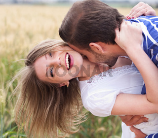 Close up of a Happy young Couple kissing  in the park
