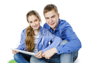 Teen age boy and girl with tablet