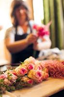 Florist making a floral arrangement from roses