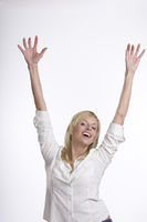 Businesswoman showing joy, both arms up, isolated