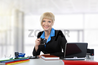 woman drinking coffee in the office.