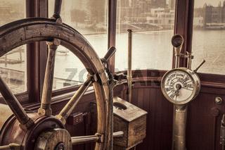 vintage ship steering wheel in sepia toning