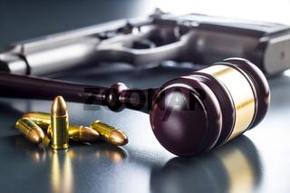 Judge gavel and gun bullets.
