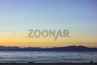 Sunset in quiet beach of l'Escala, Costa Brava.