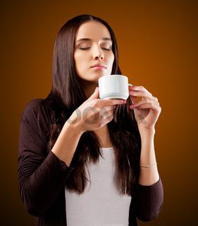 Coffee. Beautiful Girl Drinking Tea or Coffee.