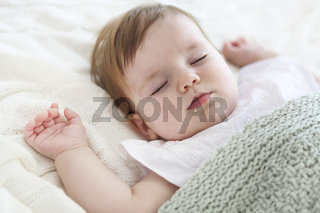 Close up portrait of a beautiful sleeping baby on white