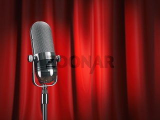 Vintage microphone on stage with red curtain. Music concept.