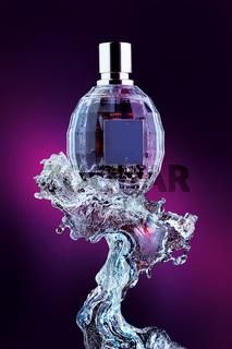 Perfume bottle on water splash