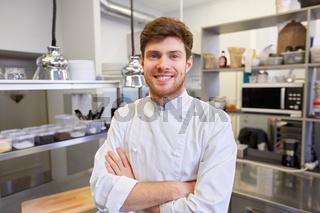 happy male chef cook at restaurant kitchen