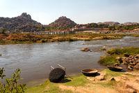 Coracle boats in Tungabhadra River, Hampi ruins, India