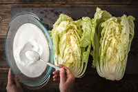 Salt, the two halves of Chinese cabbage to cook kimchi on slate
