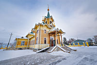 The wooden church of St. Nicholas at winter day time. Church was founded at the beginning of the 20th century. Slyudyanka. Russia.
