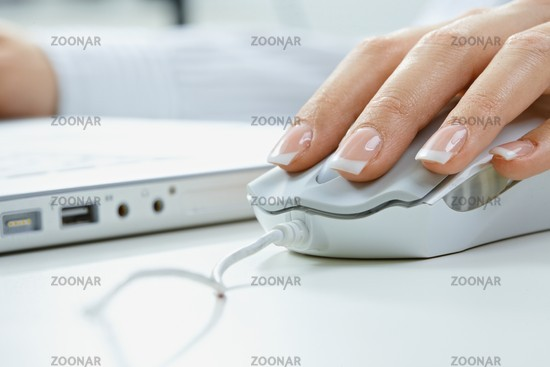 Fingers on computer mouse