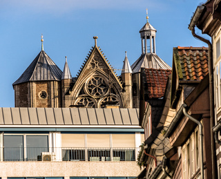 The old facade of the cathedral behind a new department store in Braunschweig, Germany