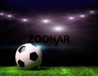Soccer ball on grass against black