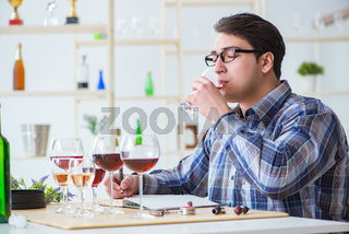 Professional sommelier tasting red wine