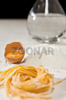 Closeup of Italian tagliatelle pasta and its ingredients