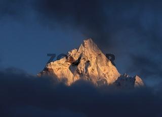 Peak of mount Ama Dablam at sunset