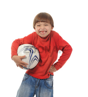 Cheerful boy with a soccer ball
