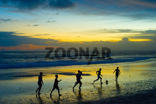 Football on the beach. silhouette