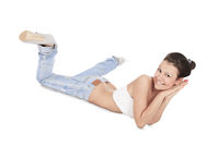 young brunette in ragged jeans posing on the floor
