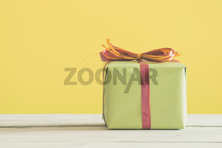 Green gift with a red and orange ribbon