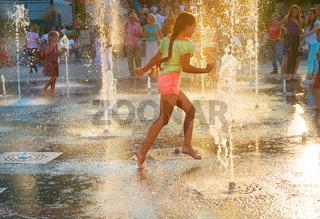 Beautiful girl in a fountain