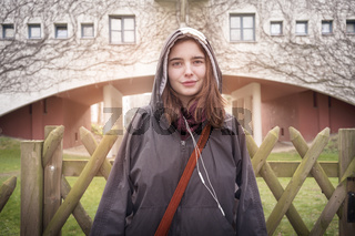 portrait of a young woman with urban background