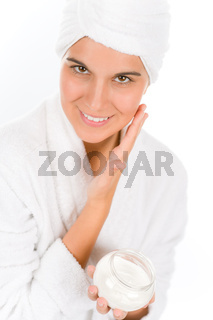 Teenager skin care - woman apply moisturizer