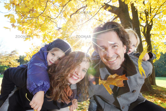 Young family in autumn park