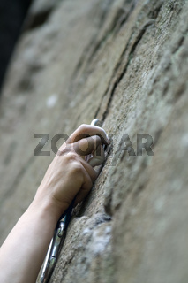 Climbers hand and quick-draws