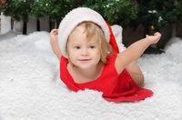 happy girl in santa costume on snow