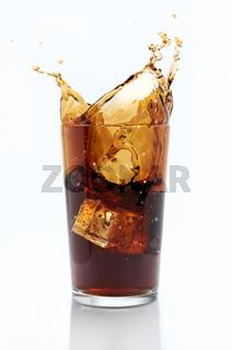 Glass of cola with splash