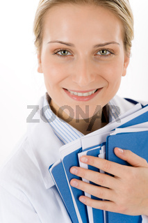 Young female doctor with medical files on white