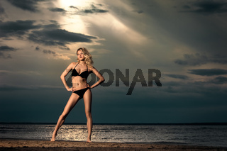 Young woman on beach in bikini.
