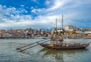 Rabelo, traditional boat with wine barrels in Porto, Portugal