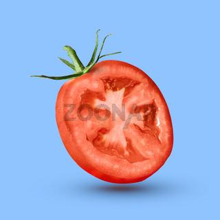 half tomato over a blue background