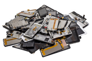 Heap of broken telephons isolated