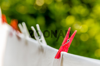 clothes hung out to dry with pegs