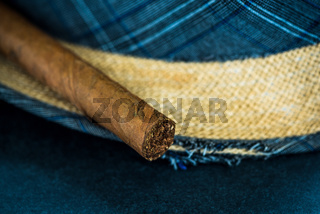 Straw Panama hat and hand rolled cigar