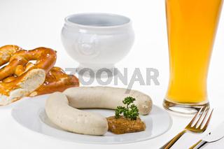 bavarian white sausage, wheat beer and pretzel
