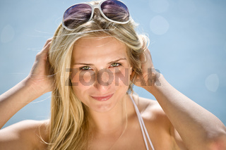 Happy blond woman enjoy summer sun on seashore