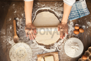 Female cooking dough.