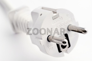 White Central European power plug as closeup on white background