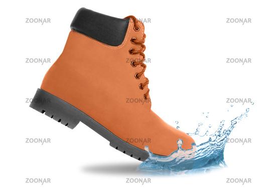 Orange boot and water splash. Side view
