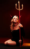 Beautiful devil with trident on black