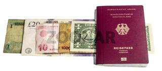 Banknotes from USA, Uganda, England, Turkey and Jordan under a passport from Germany against a white background.
