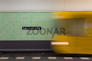 Yellow subway train in motion on Berlin Alexanderplatz underground station.
