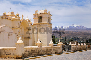 Church of the Immaculate Conception with mountains behind in Yanque, Colca Canyon, Peru.