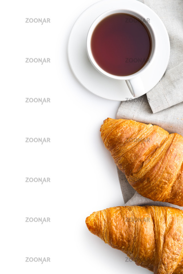 Tasty buttery croissant and cup of tea.